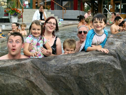 family photo at the pool area of the resort