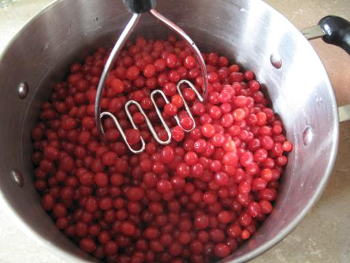 squishing the fresh cranberries