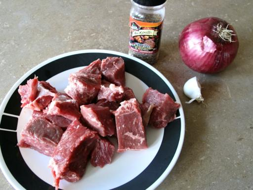 sliced steak in a plate, Montreal steal spice, red onion and garlic