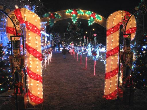 pathway with two lighted giant candy cane at the entrance