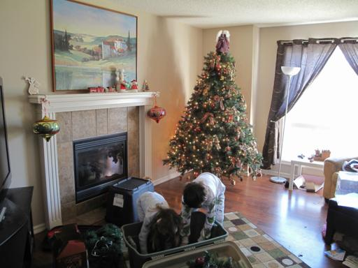 two kids busy retrieving the Christmas decors from the box