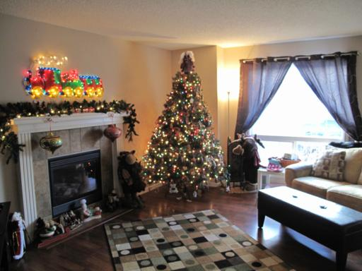 lighted Christmas tree and other decor all set up