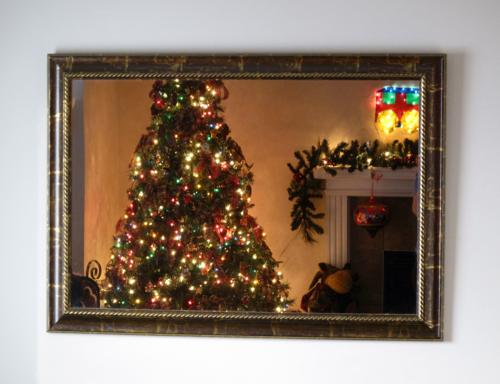 Lighted Christmas reflection in the wall mirror