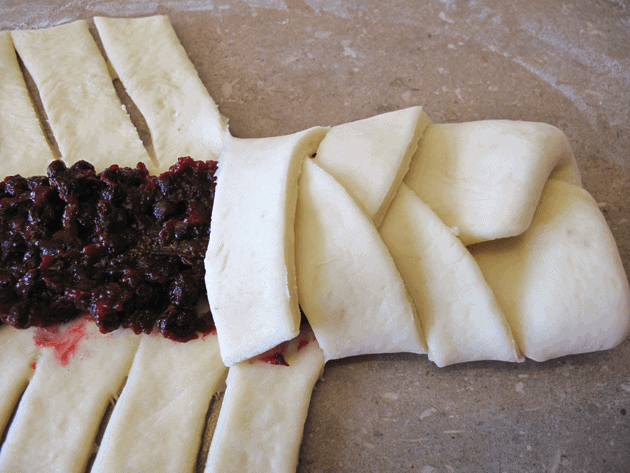 how to fold the dough criss-cross on a fruit bread braid