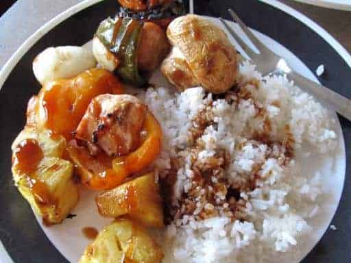 Sweet & Sour Chicken Shish Kabobs served with rice drizzled with the remaining sauce