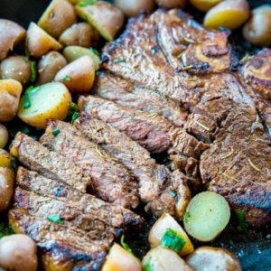 sliced Marinated then Barbecued T-Bone steak with sliced mini potatoes