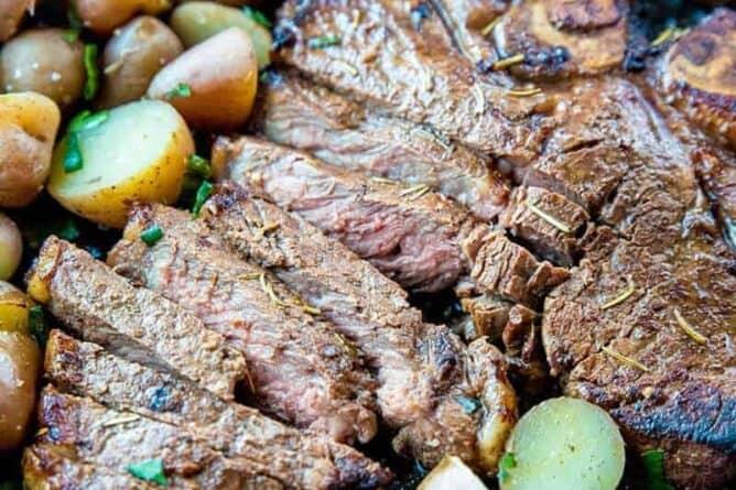 sliced Marinated then Barbecued T-Bone steak with sliced mini potatoes