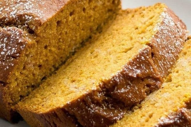 close up sliced Pumpkin Bread in a white plate