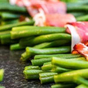 a file of bacon wrapped green bean bundles
