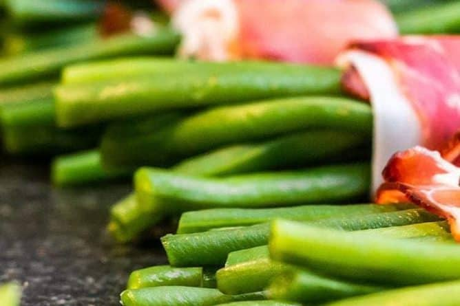 a file of bacon wrapped green bean bundles