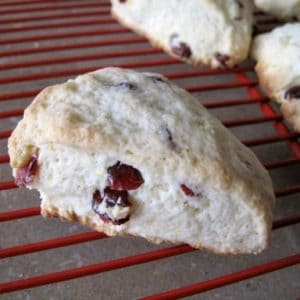 pieces of Lemon Cranberry Scones in a red cooling rack