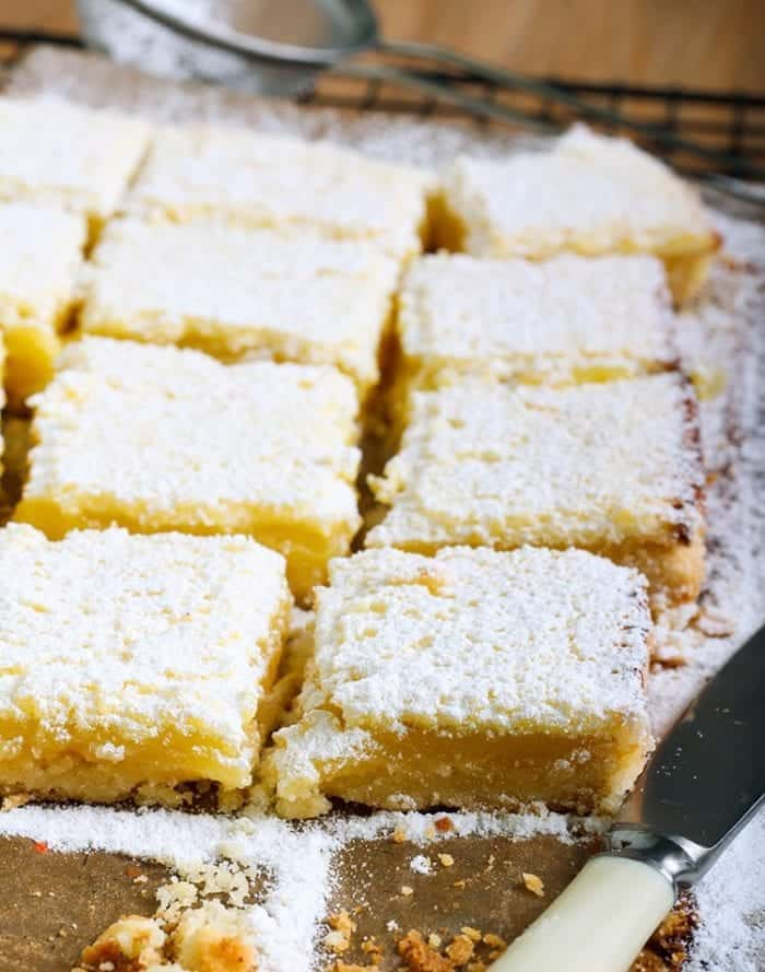 close up slices of Lemon Bars with icing sugar on top