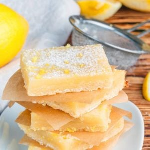 stack of Creamy Lemon Bar slices with shortbread crust