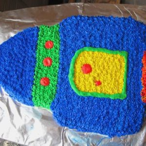 blue, green, red and yellow desiged rocket birthday cake
