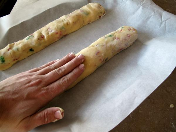 log Shaped doughs placed on a baking sheet covered with parchment paper and flattened slightly