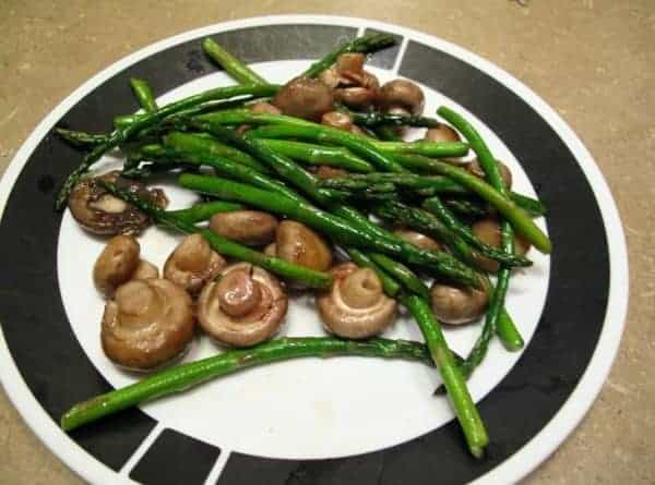 seared mushrooms and asparagus in a plate