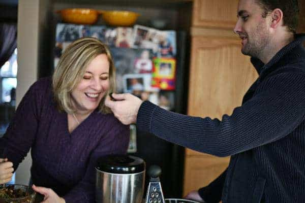 mom and dad having fun while preparing the ingredients