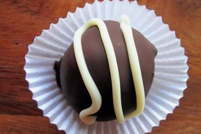 Chocolate Truffles with white chocolate topping on a cupcake liner