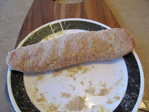 rolling the tenderloin in crumbs