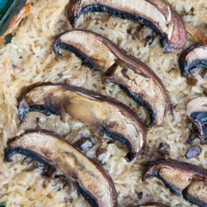 close up of Rice & Mushroom Casserole with large baked mushrooms on top