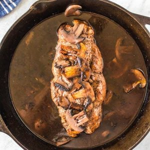 Red Wine & Mushroom Pork Tenderloin in a skillet