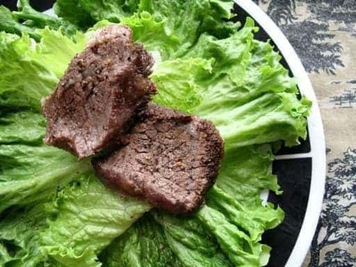 BraisedShort Ribs on top of lettuce leaves