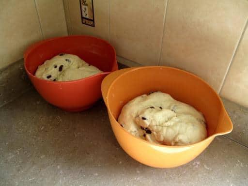 two large bowl containing Babka dough rising