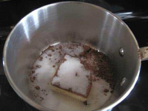 butter, cocoa and sugar together in a large pot