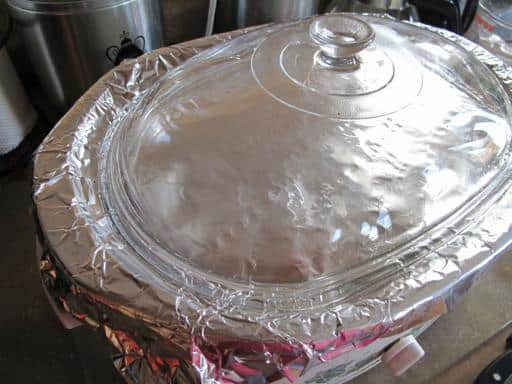 crockpot sealed with tinfoil and lid