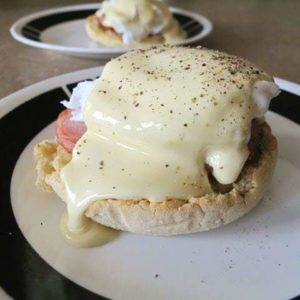 Easy eggs benedict topped with hollandaise sauce