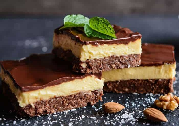 3 pieces nanaimo bars, mint leaves and walnuts