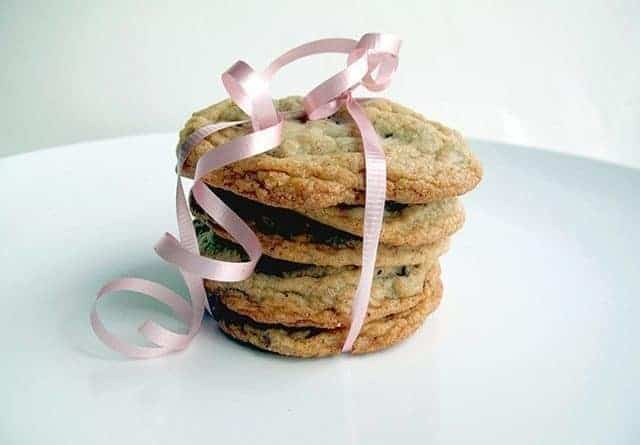 Stack of Chocolate Chunk Hazelnut Cookies with pink ribbon