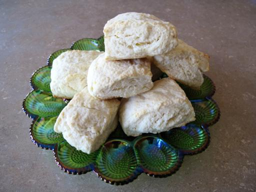 Stack of Lemon Scones in a green glass egg plate