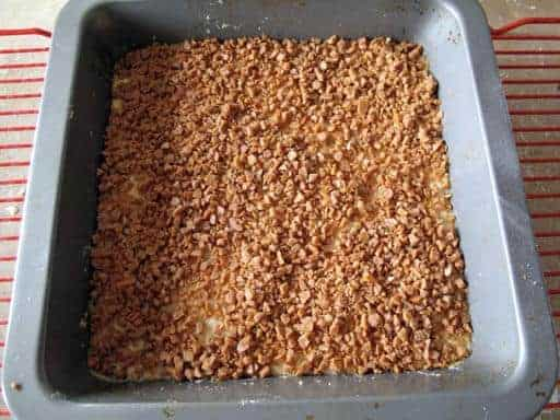 baked mixture in baking pan sprinkled with toffee bits