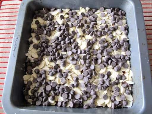adding one more layer of toppings using chocolate chips