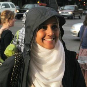 woman wearing black jacket and a neck cover
