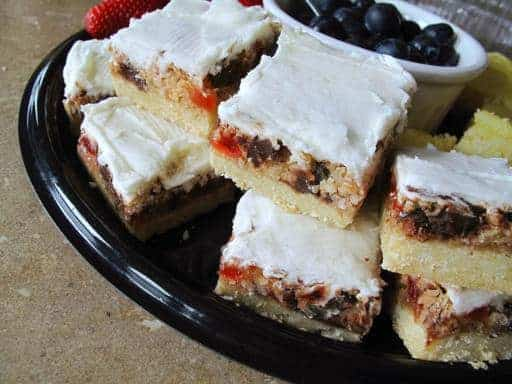Stack of Chocolate Cherry Squares with White Icing on Top