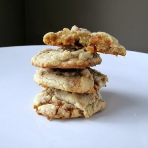Stack of Toffee Bit Cookies on white background