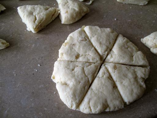 flattened dough sliced into 6 triangular parts