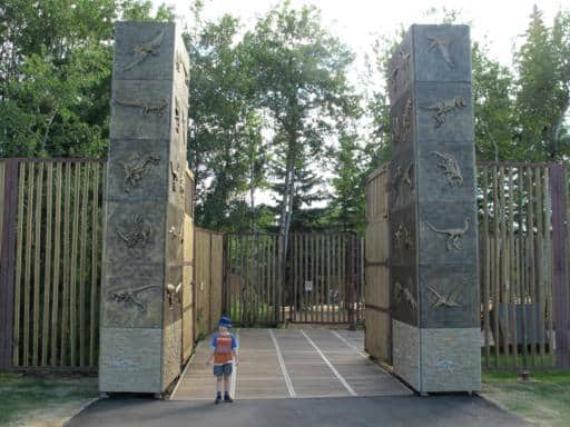 little boy in the massive entrance of the Jurassic Forest