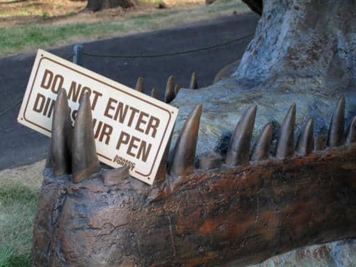 signage not to enter dinosaur pen