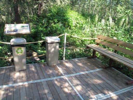 rest points, recycling and garbage bins along the walk