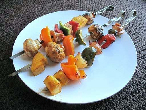 3 pieces of Sweet & Sour Chicken Shish Kabobsin a white plate