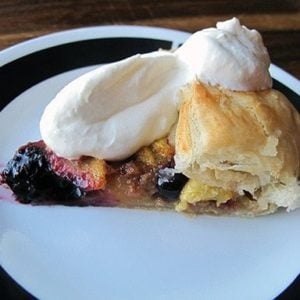 Simple & Easy Peach Blueberry Galette topped with whipped cream