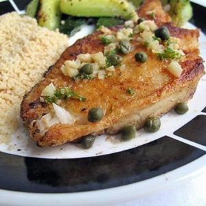 close up of Pan Seared Halibut on a plate with couscous and vegetables