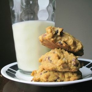 stack of Cranberry Pumpkin Cookies in a plate with a glass of milk