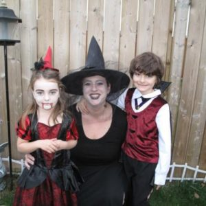 Mom and two kids wearing their halloween costumes