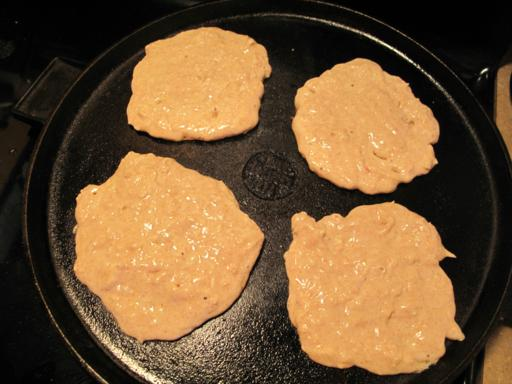 4 pieces of Apple Pie Pancakes spread out to cook