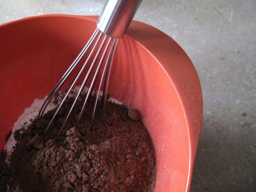 Whisking the dry ingredients in an orange bowl