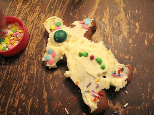 gingerbread man cookie with green M&M at the center